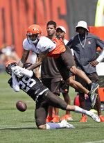 Cleveland Browns cornerback Phillip Gaines (28) defends against Cleveland Browns wide receiver Derrick Willies (84) during practice at the NFL football team's training camp facility, Saturday, July 27, 2019, in Berea, Ohio. (AP Photo/Tony Dejak)