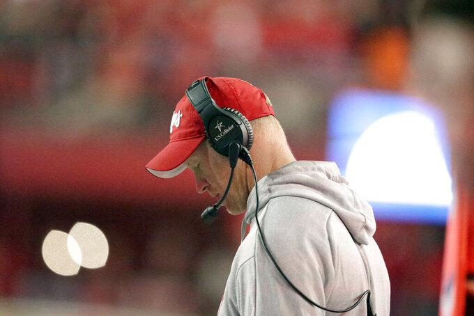 Nebraska head coach Scott Frost consults his notes during the second half of an NCAA college football game against Ohio State in Lincoln, Neb., Saturday, Sept. 28, 2019. Ohio State won 48-7. (AP Photo/Nati Harnik)