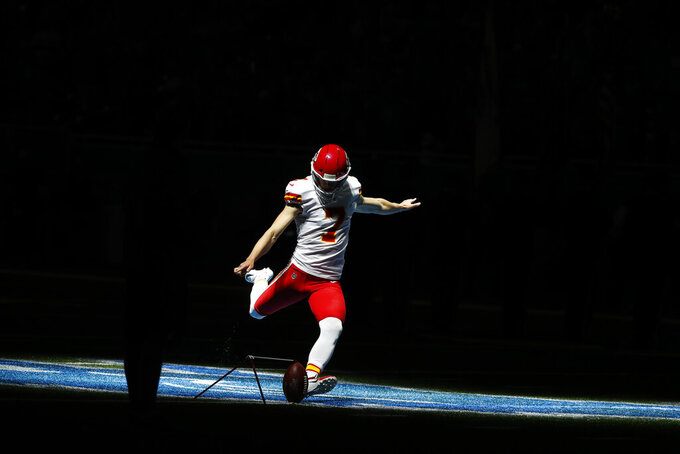 Kansas City Chiefs kicker Harrison Butker practices during pregame of an NFL football game, Sunday, Sept. 29, 2019, in Detroit. (AP Photo/Paul Sancya)