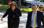 Lee Elbaz, left, accompanied by her attorney Barry Pollack arrives at federal court for jury selection in her trial in Greenbelt, Md., Tuesday July 16, 2019. Elbaz was CEO of an Israel-based company called Yukom Communications. She is accused of engaging in a scheme to dupe investors through the sale and marketing of financial instruments known as