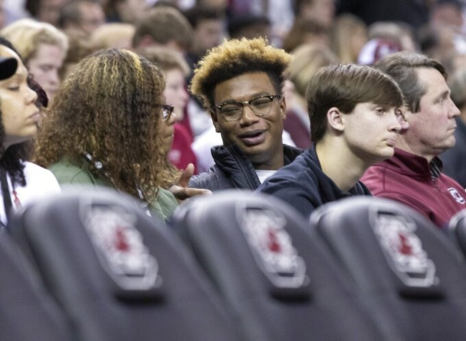 Hammond School defensive end Jordan Burch sits in the stands to watch South Carolina play Missouri at Colonial Life Arena, in Columbia, S.C., Saturday, Feb. 1, 2020. (Joshua Boucher/The State via AP)