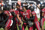 South Carolina defensive back Jaycee Horn (1) celebrates with teammates after defeating Auburn in an NCAA college football game Saturday, Oct. 17, 2020, in Columbia, S.C. South Carolina defeated Auburn 30-22. (AP Photo/Sean Rayford)