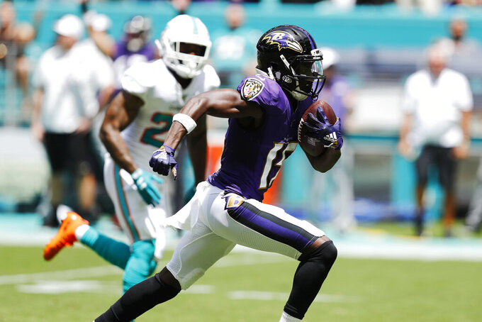 Baltimore Ravens wide receiver Marquise Brown (15) runs for a touchdown, during the first half at an NFL football game against the Miami Dolphins, Sunday, Sept. 8, 2019, in Miami Gardens, Fla. (AP Photo/Brynn Anderson)
