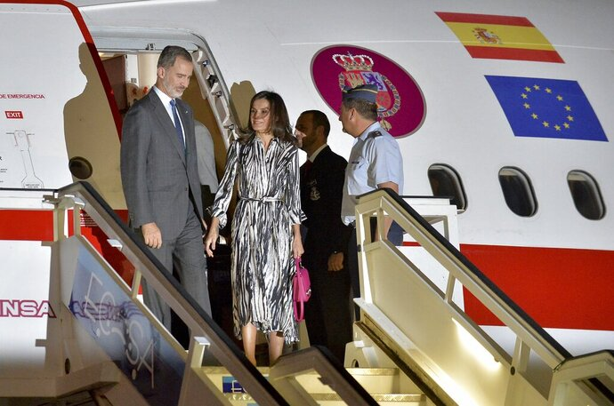 Spain's King Felipe VI and Queen Letizia arrive at the Jose Marti International airport in Havana, Cuba, Monday, Nov. 11. Spanish kings are in Havana in an official visit. (Yamil Lage/Pool photo via AP)
