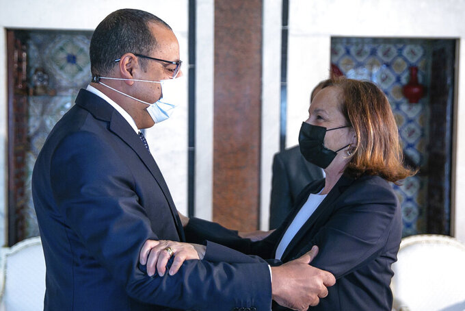 Tunisian Prime Minister Hichem Mechichi welcomes Italy's Interior Minister Luciana Lamorgese in Tunis, Thursday, May 20, 2021. Luciana Lamorgese and European Commissioner for Home Affairs Ylva Johansson are visiting Tunisia in the hope of striking a deal to reduce migrant sea-crossings. (AP Photo/Hassene Dridi)