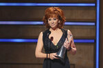 Reba McEntire accepts the Artist of a Lifetime award at 2019 CMT Artists of the Year at Schermerhorn Symphony Center on Wednesday, Oct. 16, 2019, in Nashville, Tenn. (Photo by Al Wagner/Invision/AP)