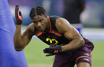 FILE - In this March 3, 2019, file photo, Stanford linebacker Bobby Okereke runs a drill during the NFL football scouting combine in Indianapolis. Indianapolis Colts general manager Chris Ballard did his homework on Bobby Okereke. And a sexual assault allegation from 2015 still didn't scare him off. Just hours after Okereke's name surfaced publicly for the first time in the case, Ballard told local reporters on a conference call that he took a hard look at Okereke's past and made others in the organization aware of the accusation before selecting the Stanford graduate in April's NFL draft.(AP Photo/Darron Cummings, File)