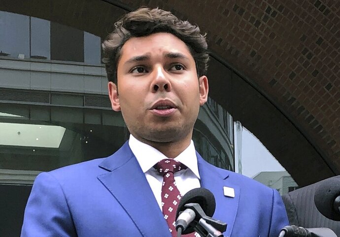 FILE - In this Sept. 6, 2019 file photo, Fall River Mayor Jasiel Correia, left, speaks outside the federal courthouse in Boston after his appearance on bribery, extortion and fraud charges. Correia, who faces multiple federal corruption charges, will face school committee member Paul Coogan in the Nov. 5 general election. (AP Photo/Philip Marcelo, File)