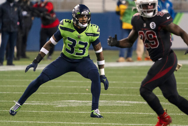 """FILE - In this Nov. 19, 2020, file photo, Seattle Seahawks defensive back Jamal Adams watches an Arizona Cardinals play develop during an NFL football game in Seattle. Adams is a big part of the story this week. """"This game is very important because like I said it's the next one,"""" Adams said on Friday. """"Obviously it is against the Jets, my former team. But I'm not here to make it about me."""" Adams spoke at length about Sunday's matchup against winless New York, the first time he'll be facing the team that drafted him with the No. 6 overall selection three years ago. (AP Photo/Stephen Brashear, File)"""
