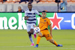 Houston Dynamo midfielder Matias Vera (22) moves the ball in front of Sporting Kansas City midfielder Gadi Kinda, left, during the first half of an MLS soccer match Wednesday, May 12, 2021, in Houston. (AP Photo/Michael Wyke)