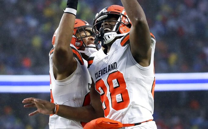 Cleveland Browns tight end Demetrius Harris, right, celebrates his touchdown catch with Pharaoh Brown in the first half of an NFL football game against the New England Patriots, Sunday, Oct. 27, 2019, in Foxborough, Mass. (AP Photo/Elise Amendola)