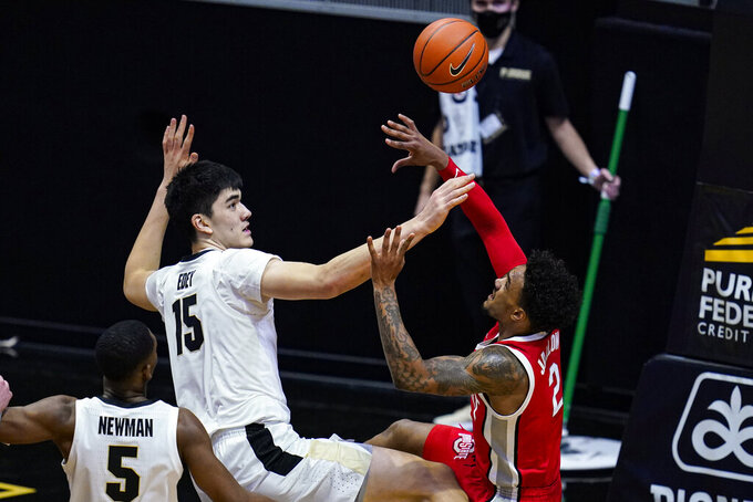 Purdue center Zach Edey (15) blocks the shot of Ohio State guard Musa Jallow (2) during the second half of an NCAA college basketball game in West Lafayette, Ind., Wednesday, Dec. 16, 2020. (AP Photo/Michael Conroy)