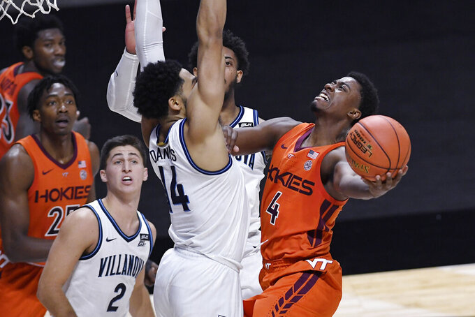 Virginia Tech's Nahiem Alleyne (4) shoots as Villanova's Caleb Daniels (14) defends during the second half of an NCAA college basketball game, Saturday, Nov. 28, 2020, in Uncasville, Conn. (AP Photo/Jessica Hill)