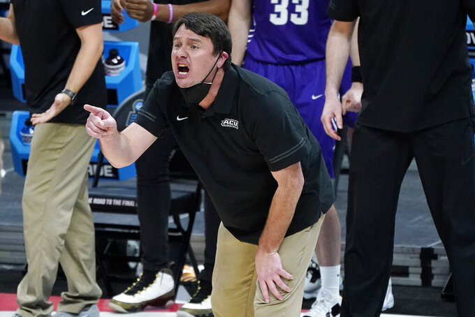 Abilene Christian head coach Joe Golding yells to his players during the first half of a college basketball game against UCLA in the second round of the NCAA tournament at Bankers Life Fieldhouse in Indianapolis Monday, March 22, 2021. (AP Photo/Mark Humphrey)