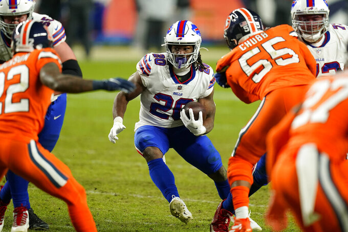 Buffalo Bills running back Zack Moss runs with the ball during the second half of an NFL football game against the Denver Broncos, Saturday, Dec. 19, 2020, in Denver. (AP Photo/Jack Dempsey)