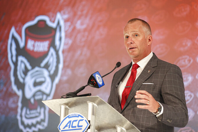 North Carolina State head coach Dave Doeren answers a question during an NCAA college football news conference at the Atlantic Coast Conference media days in Charlotte, N.C., Thursday, July 22, 2021. (AP Photo/Nell Redmond)