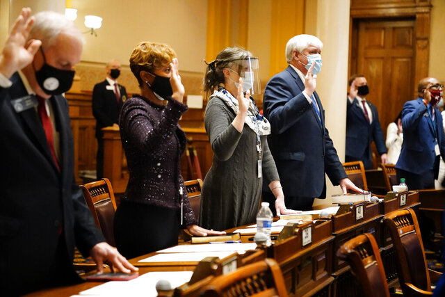 State Senators, from left, Lindsey Tippins, Sonya Halpern, Sally Harrell, and Bill Cowsert are sworn in during the opening day of the legislative sessions on Monday, Jan. 11, 2021, in Atlanta. (AP Photo/Brynn Anderson)