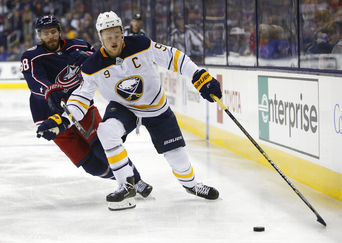Buffalo Sabres' Jack Eichel, right, carries the puck past Columbus Blue Jackets' Boone Jenner during the first period of an NHL hockey game Saturday, Oct. 27, 2018, in Columbus, Ohio. (AP Photo/Jay LaPrete)