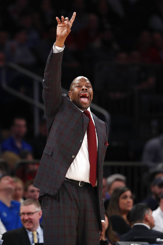 Georgetown coach Patrick Ewing gestures to his players during the second half of the team's NCAA college basketball game against St. John's in the first round of the Big East men's tournament Wednesday, March 11, 2020, in New York. (AP Photo/Kathy Willens)