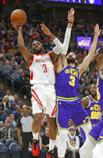 Houston Rockets guard Chris Paul (3) goes to the basket as Utah Jazz guard Ricky Rubio (3) defends in the first half during an NBA basketball game Thursday Dec. 6, 2018, in Salt Lake City. (AP Photo/Rick Bowmer)