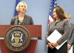Liesl Clark, left, director of the Michigan Department of Environment, Great Lakes and Energy, speaks about new lead testing rules for drinking water Wednesday, June 26, 2019, at the Romney Building in Lansing, Mich. She joined Gov. Gretchen Whitmer, right, and others to raise awareness at a time the state expects the regulations to lead to more communities exceeding lead limits. (AP Photo/David Eggert)