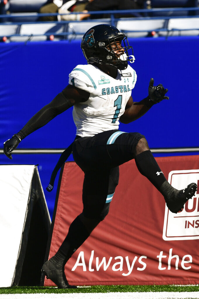 Coastal Carolina running back CJ Marable celebrates a long gain against Georgia State during the second half of an NCAA football game Saturday, Oct. 31, 2020, in Atlanta. Coastal Carolina won 51-0. (AP Photo/John Amis)