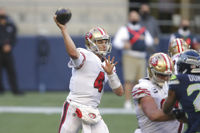 San Francisco 49ers quarterback Nick Mullens passes against the Seattle Seahawks during the second half of an NFL football game, Sunday, Nov. 1, 2020, in Seattle. (AP Photo/Scott Eklund)