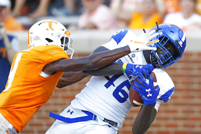 Georgia State tight end Roger Carter (45) catches a two-point conversion pass as he is defended by Tennessee defensive back Warren Burrell (4) in the second half of an NCAA college football game Saturday, Aug. 31, 2019, in Knoxville, Tenn. (AP Photo/Wade Payne)