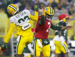 Green Bay Packers quarterback Kurt Benkert (7) and wide receiver Marquez Valdes-Scantling, left, high-five during an NFL football training camp at Lambeau Field Saturday, Aug. 7, 2021, in Green Bay, Wis. (AP Photo/Matt Ludtke)