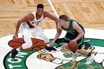 Boston Celtics' Payton Pritchard (11) drives past Portland Trail Blazers' CJ McCollum (3) during the first half of an NBA basketball game, Sunday, May 2, 2021, in Boston. (AP Photo/Michael Dwyer)