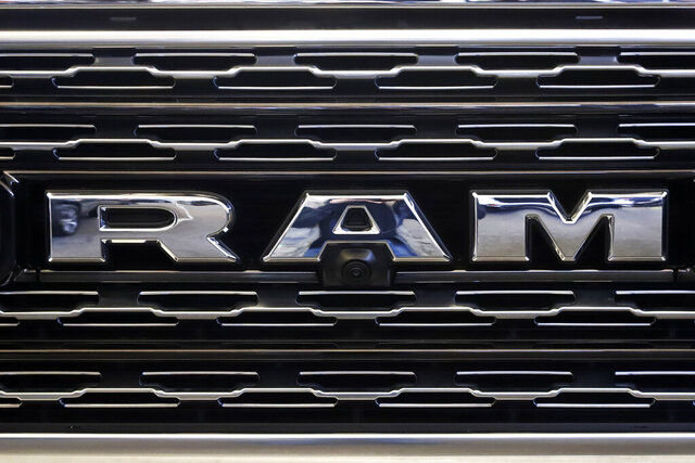 FILE - This Feb. 14, 2019, file photo shows the Ram logo on the front grill of a Ram 1500 at the 2019 Pittsburgh International Auto Show in Pittsburgh. Fiat Chrysler is recalling more than 365,000 vehicles mainly in North America, Wednesday, April 8, 2020,  because the rear view camera image can stay illuminated longer than allowed. The recall covers certain Ram pickups and Chrysler Pacifica, Dodge Durango, Jeep Grand Cherokee, Jeep Wrangler, and Jeep Renegade vans and SUVs from 2019 and 2020. (AP Photo/Gene J. Puskar, File)