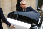 FILE - In this Dec.10, 2018 file photo, French Ecology Minister De Rugy enters his car after a meeting with French President Emmanuel Macron at the Elysee Palace in Paris. Francois de Rugy resigned Tuesday July 16, 2019 over reports of publicly funded lavish lifestyle. (AP Photo/Francois Mori, File)