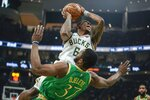 Milwaukee Bucks' Eric Bledsoe is fouled by Boston Celtics' Semi Ojeleye during the first half of an NBA basketball game Thursday, Jan. 16, 2020, in Milwaukee. (AP Photo/Morry Gash)