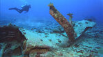 In this March 24, 2019 photo provided by Justin Taylan of PacificWrecks.com, a scuba diver swims near the left wing wreckage of an F4U-4 Corsair fighter aircraft off Sonai, Iriomote Jima, in Japan. World War II researcher Justin Taylan says the airplane wreckage on the ocean floor near Okinawa is from the fighter-bomber flown by John McGrath, a U.S. pilot from New York who's still listed as missing in action. (Justin Taylan via AP)