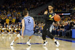Marquette's Markus Howard, right, drives past Villanova's Collin Gillespie (2) during the first half of an NCAA college basketball game Saturday, Jan. 4, 2020, in Milwaukee. (AP Photo/Aaron Gash)