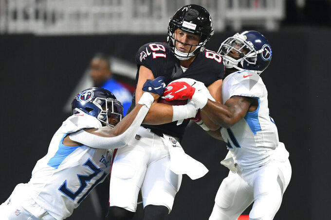 Atlanta Falcons tight end Austin Hooper (81) is hit by Tennessee Titans free safety Kevin Byard (31) during the first half of an NFL football game, Sunday, Sept. 29, 2019, in Atlanta. (AP Photo/John Amis)