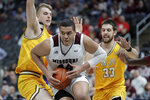 Missouri State's Gaige Prim, center, heads to the basket past Valparaiso's Ben Krikke and John Kiser (33) during the second half of an NCAA college basketball game in the semifinal round of the Missouri Valley Conference men's tournament Saturday, March 7, 2020, in St. Louis. (AP Photo/Jeff Roberson)