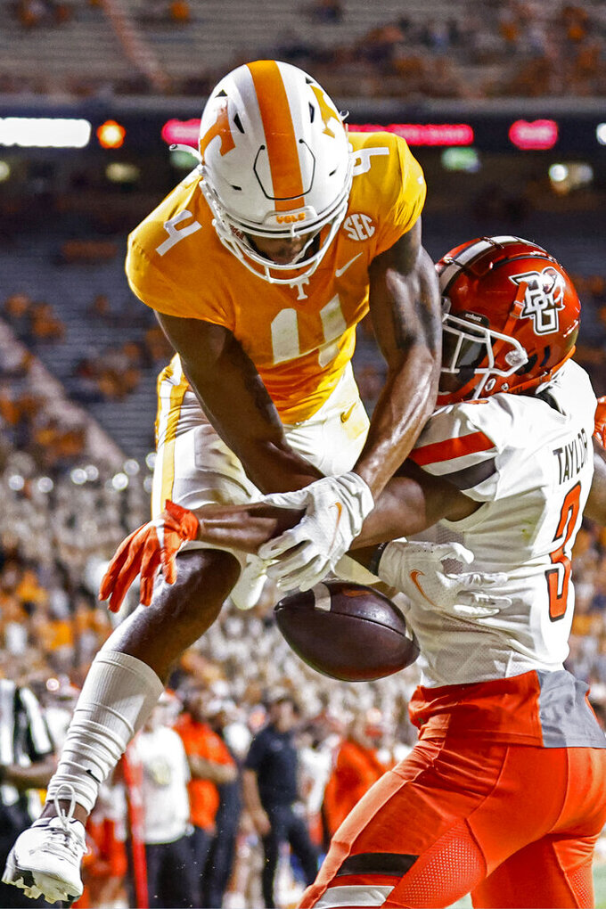 Tennessee wide receiver Cedric Tillman (4) can't hold on to the ball as he's defended by Bowling Green's Devin Taylor (3) during the second half of an NCAA college football game Thursday, Sept. 2, 2021, in Knoxville, Tenn. (AP Photo/Wade Payne)