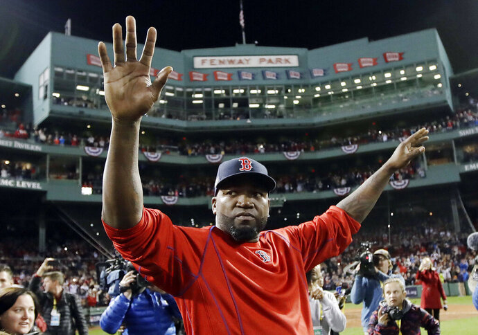 FILE - In this Oct. 10, 2016, file photo, Boston Red Sox's David Ortiz waves from the field at Fenway Park after Game 3 of baseball's American League Division Series against the Cleveland Indians in Boston. Officials say Ortiz, who was shot in the Dominican Republic on June 9, 2019, at an outdoor cafe, was the victim of incompetent criminals who were trying to kill a man next to him. (AP Photo/Charles Krupa, File)