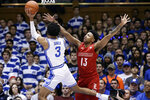 Duke guard Tre Jones (3) shoots while Louisville guard David Johnson (13) defends during the first half of an NCAA college basketball game in Durham, N.C., Saturday, Jan. 18, 2020. (AP Photo/Gerry Broome)
