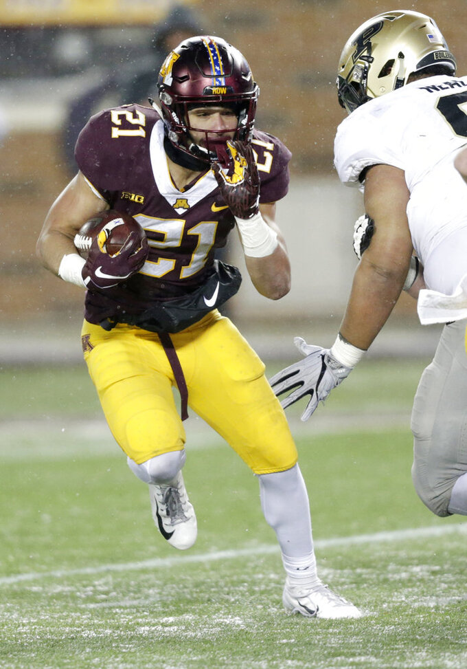 Minnesota running back Bryce Williams (21) runs against Purdue in the third quarter in a NCAA college football game Saturday, Nov. 10, 2018, in Minneapolis. (AP Photo/Andy Clayton-King)
