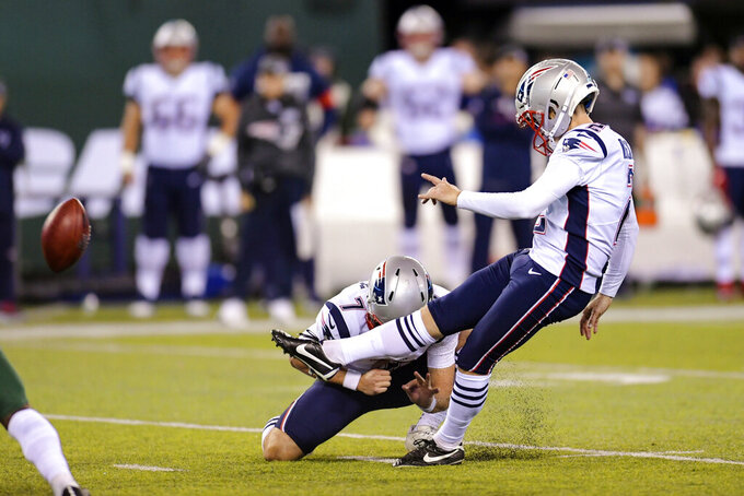 New England Patriots kicker Mike Nugent, right, boots a field goal during the first half of an NFL football game against the New York Jets, Monday, Oct. 21, 2019, in East Rutherford, N.J. (AP Photo/Bill Kostroun)