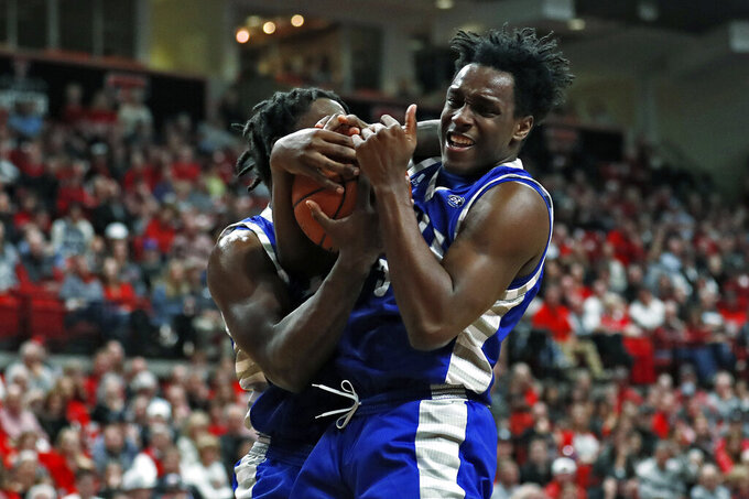 Eastern Illinois' George Dixon (35) and Mack Smith (3) rebound the ball during the first half of an NCAA college basketball game against Texas Tech, Tuesday, Nov. 5, 2019, in Lubbock, Texas. (AP Photo/Brad Tollefson)