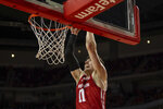 Wisconsin forward Micah Potter (11) makes a dunk against Nebraska during the first half of an NCAA college basketball game in Lincoln, Neb., Saturday, Feb. 15, 2020. (AP Photo/John Peterson)