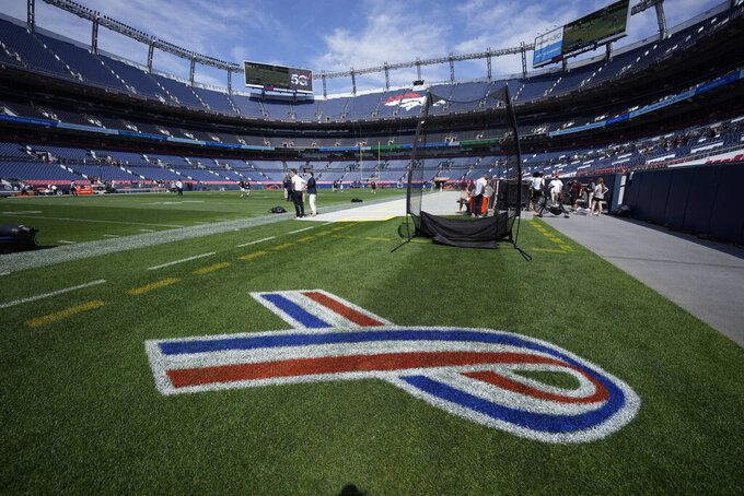 A red, white and blue ribbon, to mark Sept. 11, 2001 anniversary, marks the field near the Texas A&M bench before an NCAA college football game against Colorado, Saturday, Sept. 11, 2021, in Denver. (AP Photo/David Zalubowski)