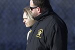 Michelle Carter, left, leaves the Bristol County jail, Thursday, Jan. 23, 2020, in Dartmouth, Mass., after serving most of a 15-month manslaughter sentence for urging her suicidal boyfriend to kill himself in 2014. The 23-year-old, released three months early for good behavior, will serve five years of probation. (AP Photo/Steven Senne)