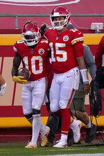 Kansas City Chiefs wide receiver Tyreek Hill (10) and quarterback Patrick Mahomes (15) celebrate after connecting on a touchdown pass against the Carolina Panthers during the second half of an NFL football game in Kansas City, Mo., Sunday, Nov. 8, 2020. (AP Photo/Jeff Roberson)