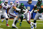 New York Jets running back Le'Veon Bell (26) is stopped by Buffalo Bills defensive ends Trent Murphy, center left, and Quinton Jefferson, center right, during the first half of an NFL football game in Orchard Park, N.Y., Sunday, Sept. 13, 2020. (AP Photo/Jeffrey T. Barnes)