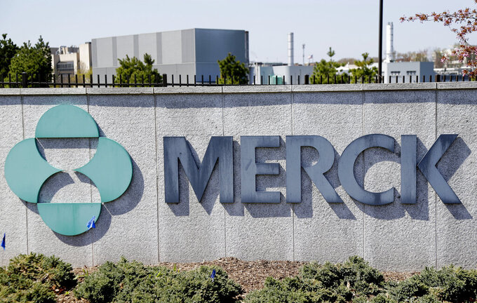FILE- This May 1, 2018, file photo shows Merck corporate headquarters in Kenilworth, N.J. Merck posted a big fourth-quarter loss, mainly due to much higher spending on research, production and overhead, and announced longtime chief executive, Kenneth Frazier, will retire on July 1, 2021.  (AP Photo/Seth Wenig, File)