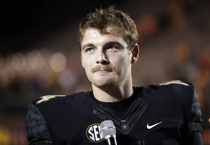 "FILE - In this Nov. 24, 2018, file photo, Vanderbilt quarterback Kyle Shurmur is interviewed after Vanderbilt beat Tennessee in an NCAA college football game, in Nashville, Tenn. There's one quarterback at the NFL scouting combine that New York Giants coach Pat Shurmur has absolutely fallen in love with. It's Kyle Shurmur, his 22-year-old son who threw 50 touchdowns over the last two seasons as Vanderbilt's starter. ""Well, I'm extremely proud of him,"" the Giants coach said. (AP Photo/Mark Humphrey, File)"